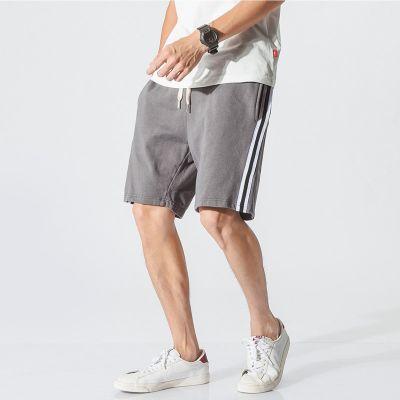 Short sport vintage pour homme avec bandes côtés retro