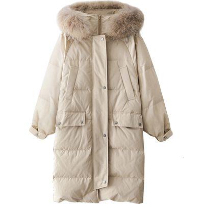 Manteau matelassé capuche fourrure pour femme