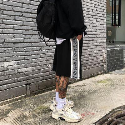 Short homme style baggy avec bandes reflectives