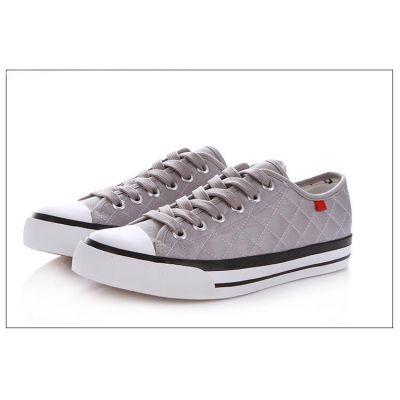 Chaussures basses tennis tissage Losange avec semelle et bout blancs