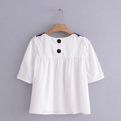T-shirt léger été pour femme avec détail dentelle épaule et boutons au dos