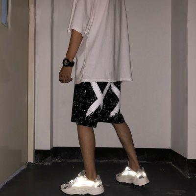 Short sport homme oversize avec bande élastiquée à la taille